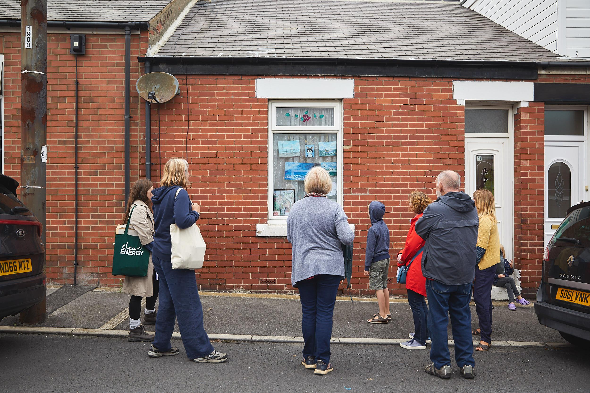 People viewing artworks displayed as part of Dawdon Street Gallery